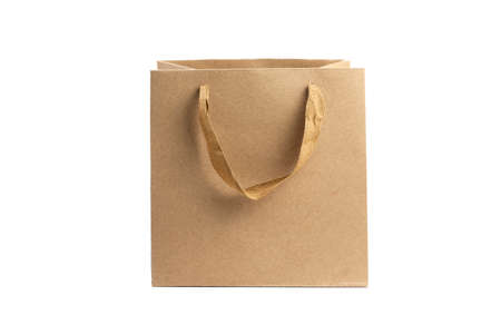 Photo for Recycled craft paper bag on white. Shopping paper bag isolated on white background. Paper bag mock up for design - Royalty Free Image