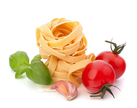 Italian pasta fettuccine nest  and cherry tomato isolated on white background