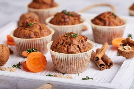 Foto für Muffins with carrot, walnuts and cinnamon. Delicious homemade appetizer - Lizenzfreies Bild