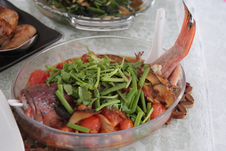Steamed fish arranged on a glass platter