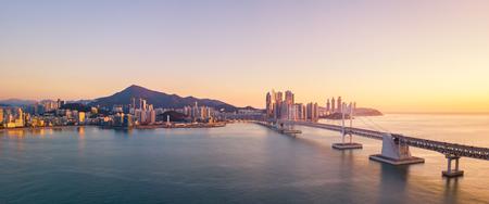 Photo pour Gwangan Bridge and Haeundae aerial view at Sunrise, Busan, South Korea - image libre de droit