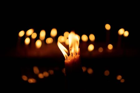Photo for candles and lights  on a black background with boken lights. - Royalty Free Image