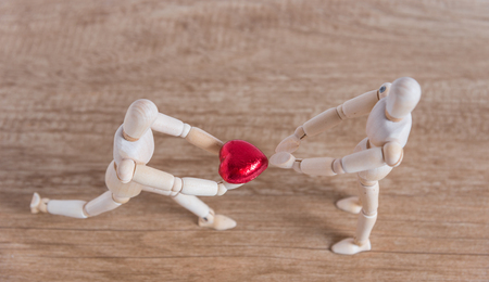 A wooden doll man in a valentine theme show his love to his couple and ask for love
