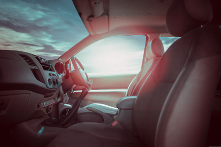 Sunset, sunlight viewed from inside a car