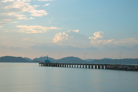 Empty sea pier at Rayong military beach with strong sun ray and flare