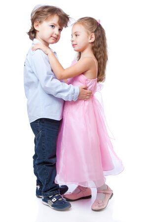 Little boy and girl in love. Isolated on white background