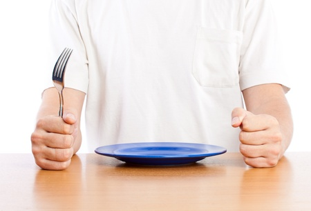 A man is waiting for a dinner. Isolated on a white background