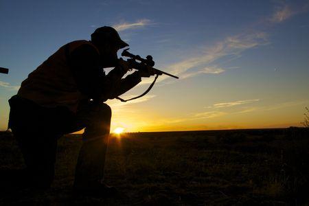 Rifle Hunter in Sunset