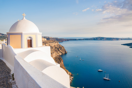 White architecture on Santorini island, Greece.  Beautiful landscape with sea view at sunset