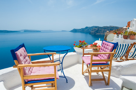 Beautiful terrace with sea view. White architecture on Santorini island, Greece.