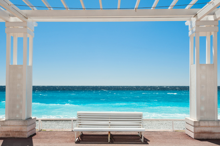 Photo for White benches on the Promenade des Anglais in Nice, France. Beautiful turquoise sea and beach - Royalty Free Image