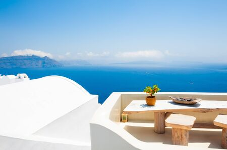 Photo for White architecture on Santorini island, Greece. Beautiful terrace with sea view. Travel destinations concept - Royalty Free Image