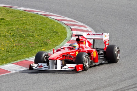 BARCELONA, SPAIN - FEBRUARY 18, 2011: Fernando Alonso of Ferrari team driving his F1 car during Formula One Teams Test Days at Catalunya circuit.
