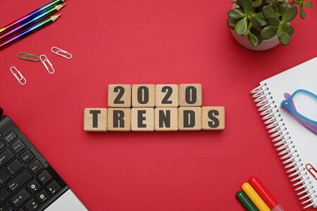 Photo pour 2020 trends concept - flat lay composition with wooden cubes at office workspace on red table - image libre de droit
