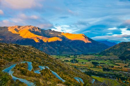 sunrise rural scenery and mountains near arrowtown and queenstown new zealand.