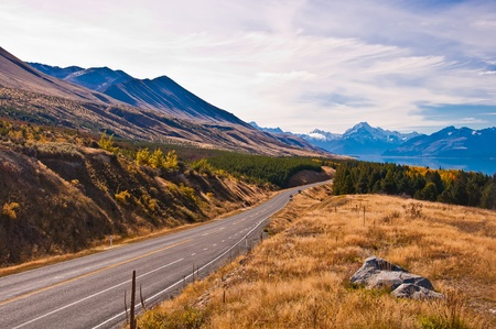 Regional road at Lake Pukaki with Mt. Cook in background (the highest mountain in New Zealand). South Island. New Zealand