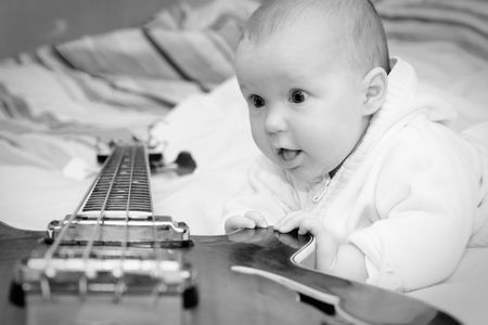 Four month baby girl and the bass guitar, black & white shot