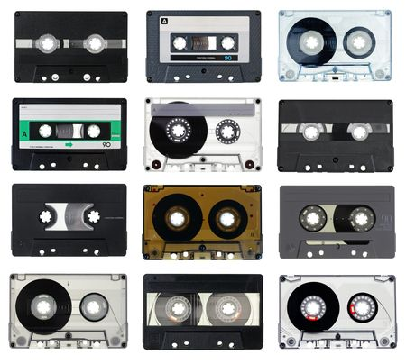 Collection of vintage Compact Cassettes on white background