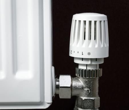 Thermostatic radiator valve set to minimal temperature close-up