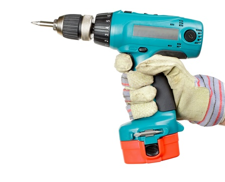 Hand wearing protective glove holding battery-powered electric drill on white background