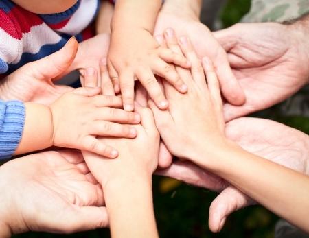 Photo pour Family holding hands together closeup - image libre de droit