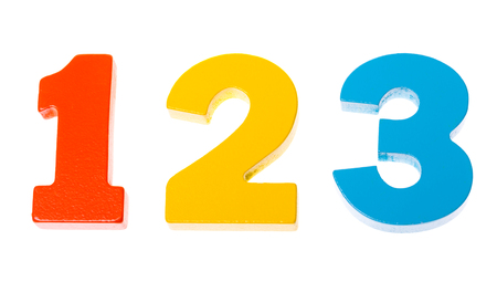 Foto de Colorful wooden toy numbers one two three on white background - Imagen libre de derechos