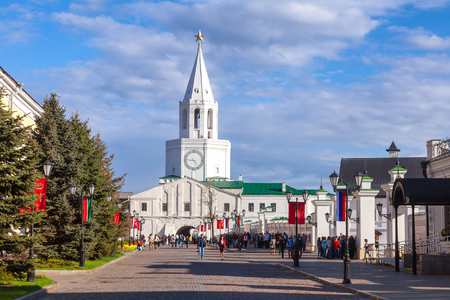 KAZAN, TATARSTAN, RUSSIA - MAY, 8 2016: Visitors walking through the Spasskaya Tower of the Kazan Kremlin on a sunny spring day. Kazan Kremlin is a UNESCO World Heritage Site and  historic citadel of Tatarstan in Russia