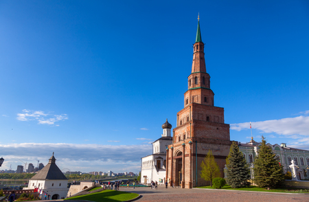 KAZAN, TATARSTAN, RUSSIA - MAY, 8 2016: Visitors walking along leaning Soyembika Tower (Khan's Mosque), the most familiar landmark and architectural symbol of Kazan. Kazan Kremlin is a UNESCO World Heritage Site and  historic citadel of Tatarstan in Russi