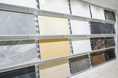 Foto de Colorful samples of a stone tile in store. Marble and granite flooring a most popular choice for modern kitchens and bathrooms. - Imagen libre de derechos