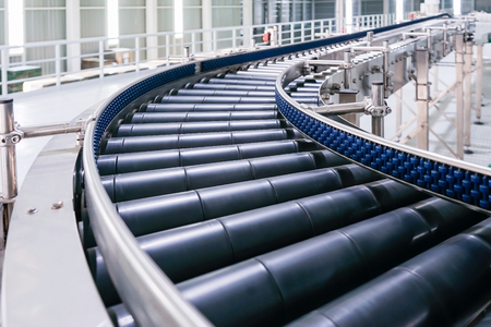 Photo pour Crossing of the roller conveyor, Production line conveyor roller transportation objects. - image libre de droit