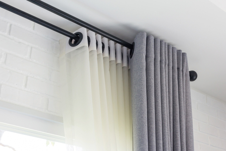 Photo pour The white curtains with ring-top rail, Curtain interior decoration in living room - image libre de droit