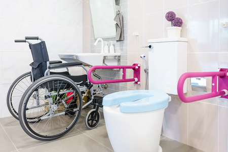 Foto de Toilet for the elderly and the disabled.It have two-sided handle for support the body and slip protection. Safety public toilet. - Imagen libre de derechos