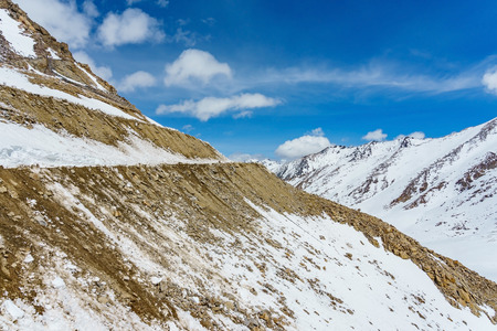 Khardung La pass, India. Khardung La is a high mountain pass located in the Ladakh region of the Indian state of Jammu and Kashmir. The elevation of Khardung La is 5,359 m