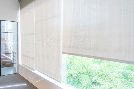 Photo pour Roll Blinds on the windows, the sun does not penetrate the house. Window in the Interior Roller Blinds. Beautiful Blinds on the Window - image libre de droit