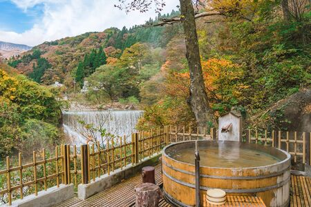 Photo for Japanese Hot Springs Onsen Natural Bath Surrounded by red-yellow leaves. In fall leaves fall in Fukushima, Japan. - Royalty Free Image