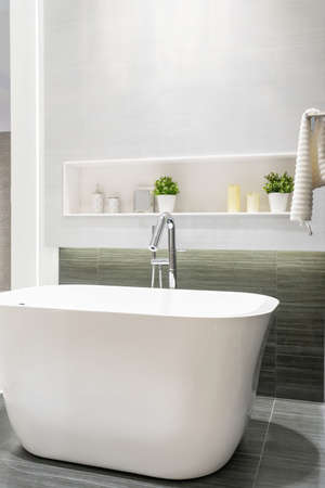 Photo pour Modern bathroom interior with minimalistic shower and lighting, white toilet, sink and bathtub - image libre de droit
