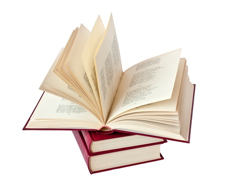 Stack of books in a red leather cover with gold lettering with one book open