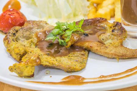 Photo pour yummy pork steak on white dish - image libre de droit