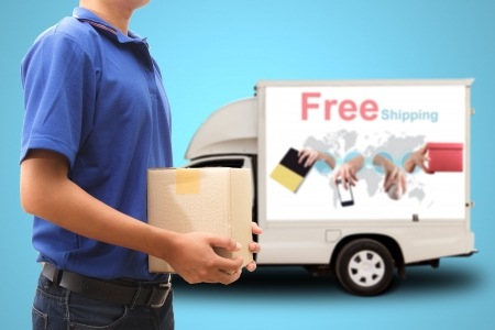 Photo for Delivery man with free shipping car - Royalty Free Image