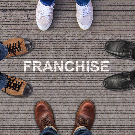 four pairs of shoes with franchise