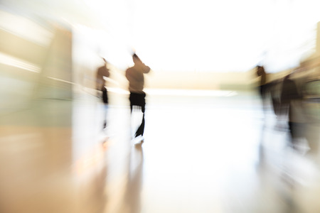 Business people rushing in the lobby. motion blurの写真素材
