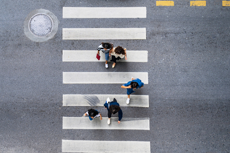 Photo pour Aerial photo top view of people walk on street in the city over pedestrian crossing traffic road - image libre de droit
