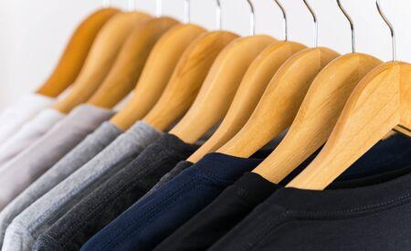 Photo pour Close up of T-shirts on hangers, apparel background - image libre de droit