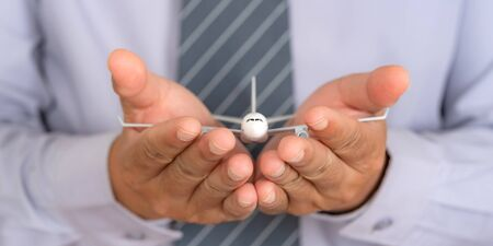 Photo for Insurance travel concept, Airplane model on Support hands, Protection plane safe protect - Royalty Free Image