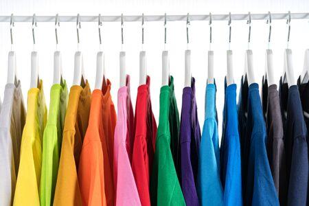 Photo pour Close Up of t-shirts, Clothes on hangers on white background - image libre de droit
