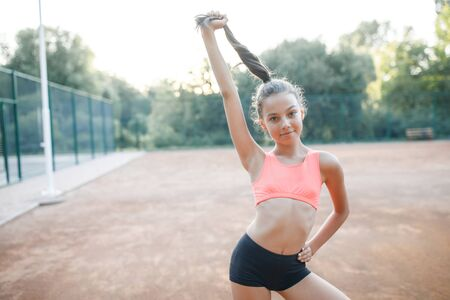 Foto de A pretty girl loves a teenager resting after an outdoor workout. Lifestyle - Imagen libre de derechos