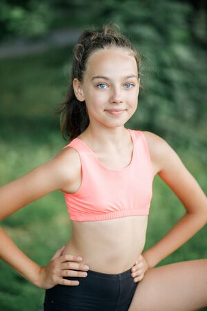 Photo pour A pretty girl loves a teenager resting after an outdoor workout. Lifestyle - image libre de droit