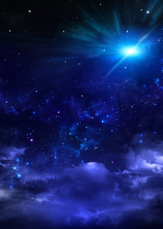 cloudy night sky filled with many stars