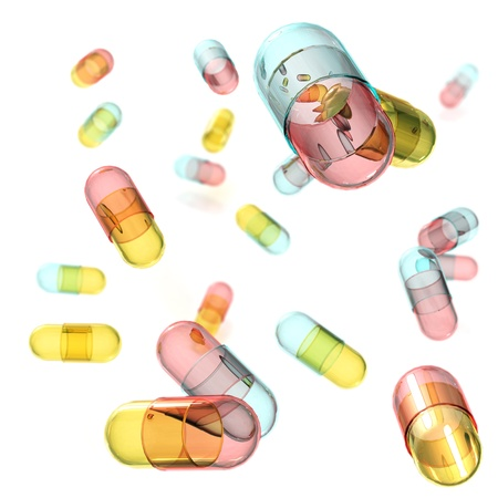 Falling pills on white