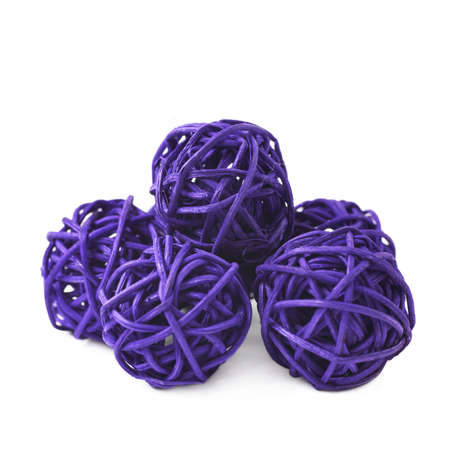 Pile of decorative colored straw balls isolated over the white background